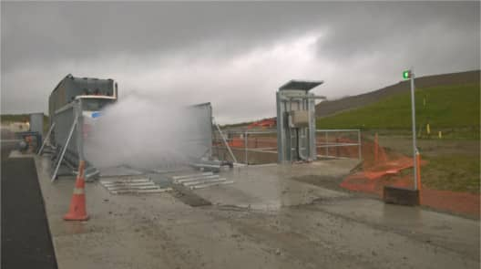 Truck going through heavy duty wheel wash